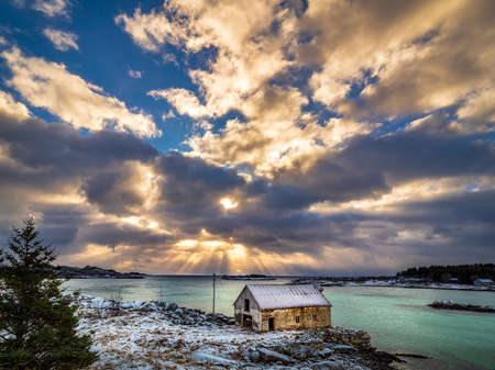 Sun rays and cottage