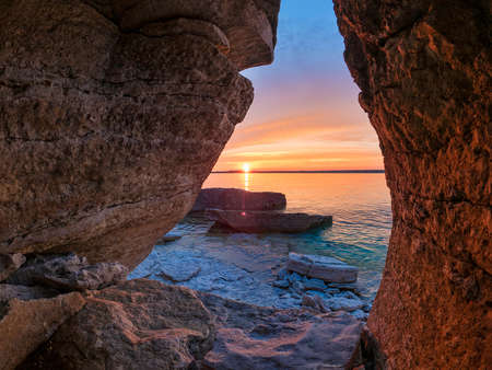 Sunset from crevice on shore